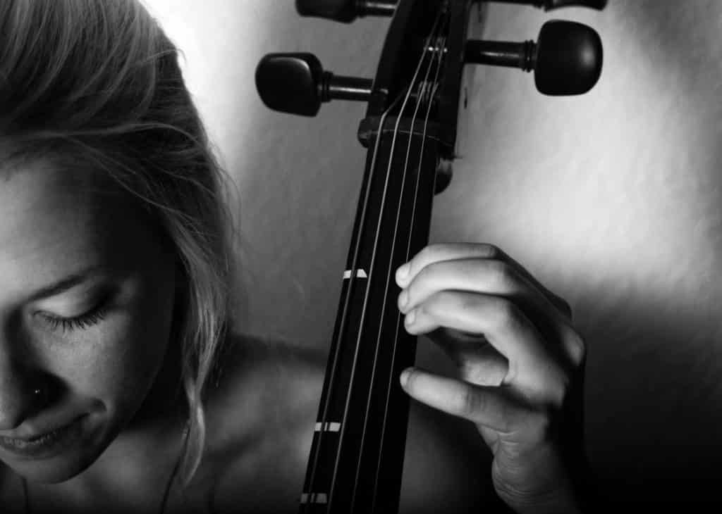 A photograph of a woman and an instrument