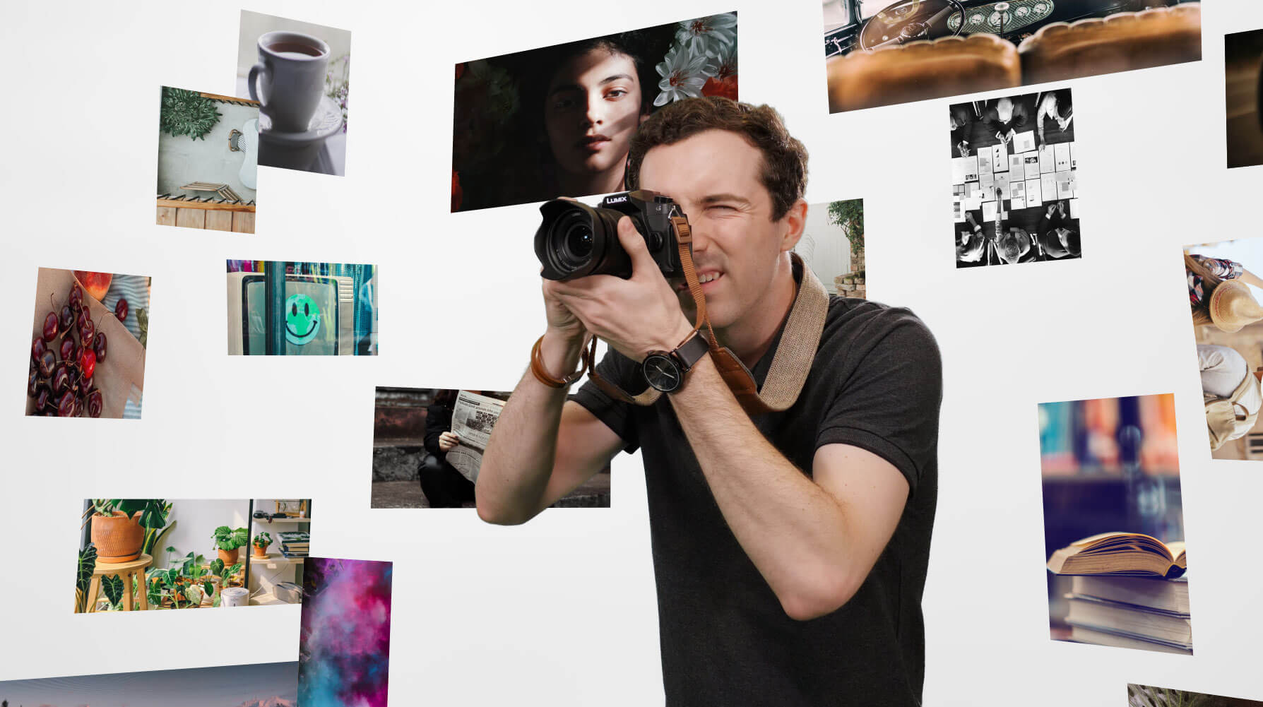 photography student in front of various photographs